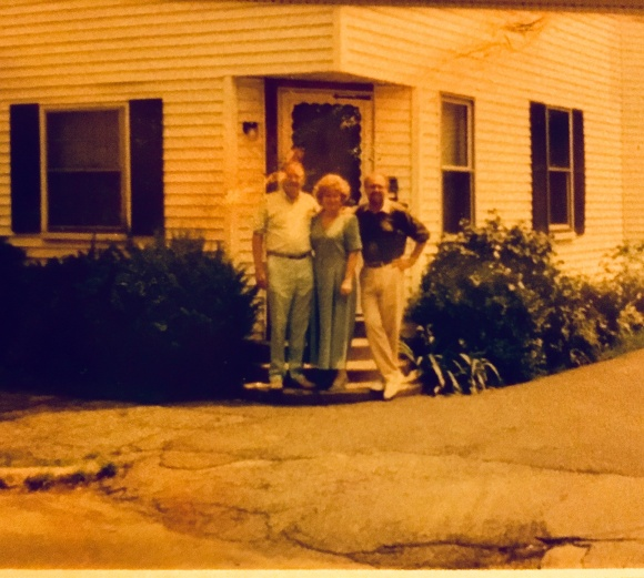 east coast old pic of dad and sibs as adults in doorway